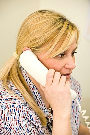woman on landline phone