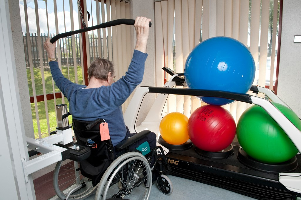 wheel chair user with gym equipment