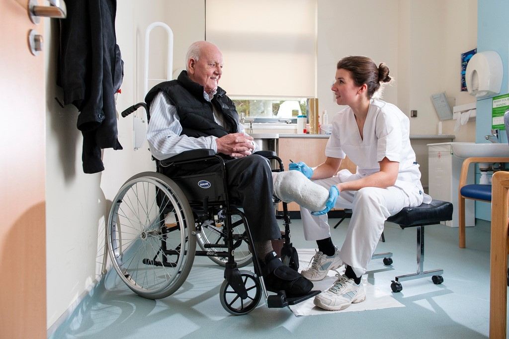 prosthetist working with patient in clinic