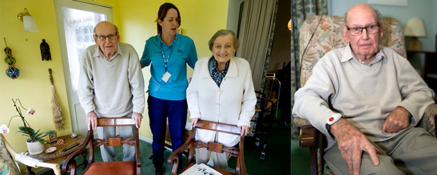 Elderly couple at home with physio nurse