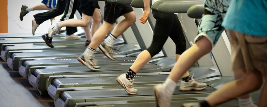 Image of people running on a treadmill