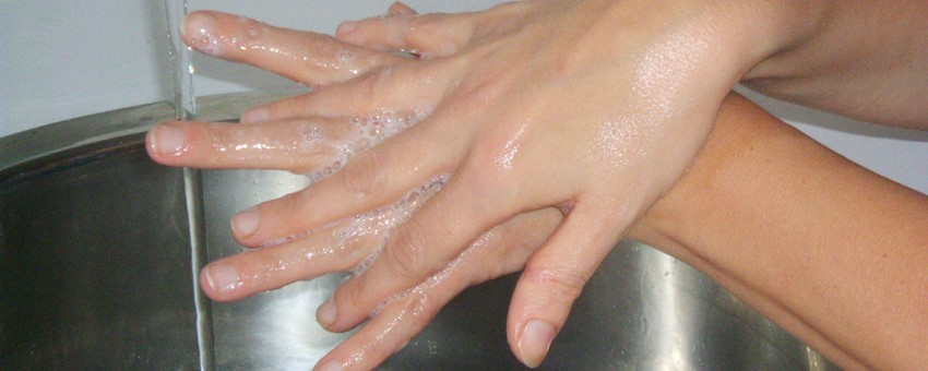 Someone washing hands to help prevent infection.