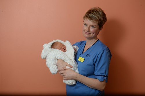 Midwife Hilary Alba with newborn baby