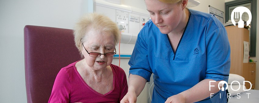 Food First - Nurse assisting patient