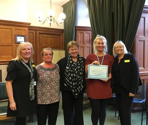 Staff with Award Certificate