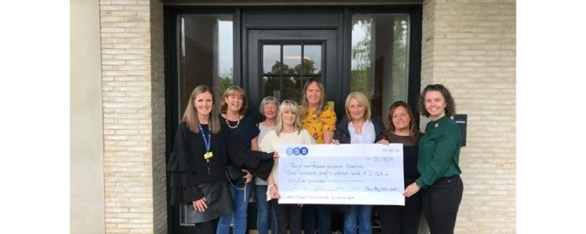Gin & Jammies Cheque Handover to Hospice